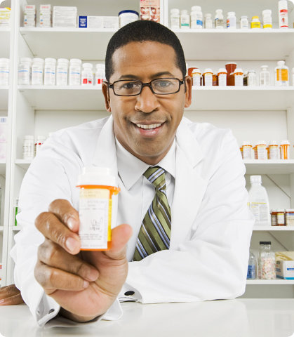 male pharmacist holding a bottle of medicine